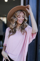 Model wearing a blush Oversized Top