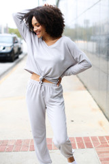 Model wearing a grey Soft Knit Knotted Top with the matching joggers