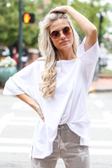 Model wearing a Basic Oversized Tee with flare jeans