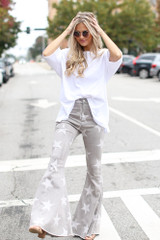 Model wearing High-Rise Star Flare Jeans