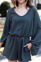 Olive - Model wearing a Balloon Sleeve Romper with ankle booties