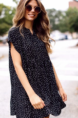 Model wearing a Polka Dot Babydoll Dress with booties