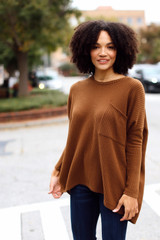 Brown - Model wearing an Oversized Waffle Knit Top with jeans