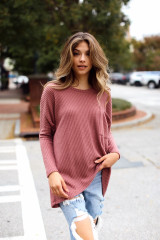 Mauve - Dress Up model wearing an Oversized Waffle Knit Top with distressed jeans