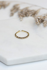 Flat Lay of a Gold Rhinestone Ring