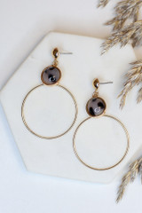 Flat Lay of Gold Statement Earrings