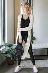 Ivory - Model wearing a Knit Duster Cardigan with a black bodysuit