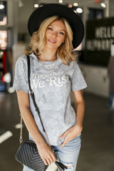 Model wearing the Together We Rise Graphic Tee