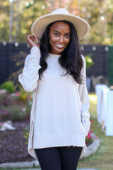Taupe - Model wearing an Oversized Brushed Knit Pullover with a wide brim hat