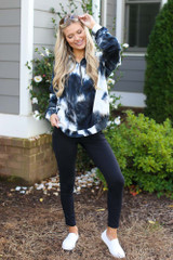 Model wearing a Tie-Dye Quarter Zip Pullover with black leggings