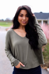 Olive - Model wearing a Basic V-Neck Tee with flare jeans