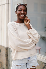 Ivory - Model wearing a Waffle Knit Top with denim shorts