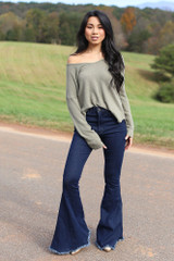 Model wearing a Waffle Knit Thermal Top in Olive with flare jeans