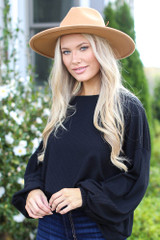Black - Model wearing a Ribbed Balloon Sleeve Pullover with a wide brim hat