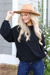 Black - Dress Up model wearing a Ribbed Balloon Sleeve Pullover with a wide brim hat