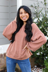 Rust - Model wearing a Ribbed Balloon Sleeve Pullover with skinny jeans
