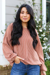 Rust - Dress Up model wearing a Ribbed Balloon Sleeve Pullover with skinny jeans