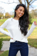 White - Model wearing a Ribbed Knit Top with dark wash jeans