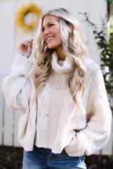 Ivory - Model wearing an Oversized Cable Knit Sweater