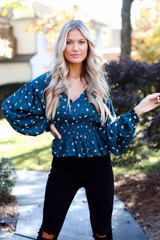 Model wearing a Smocked Floral Blouse