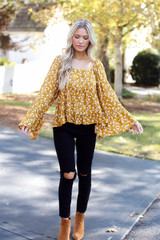 Model wearing a Floral Blouse with black jeans