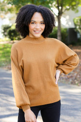 Camel - Model wearing a Luxe Knit Mock Neck Sweater with black jeans