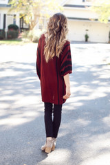 Model wearing an Oversized Striped Sweater Tunic Back View