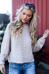 Model wearing a Cable Knit Sweater