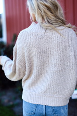 Close Up of a Cable Knit Sweater Back View