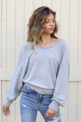 Heather Grey - Model wearing a Brushed Knit Top with distressed skinny jeans