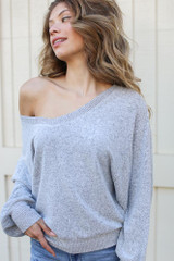 Heather Grey - Dress Up model wearing a Brushed Knit Top with distressed skinny jeans