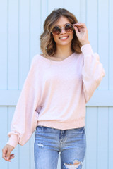 Blush - Model wearing a Brushed Knit Top with skinny jeans