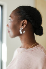 Dress Up model wearing Acrylic Hoop Earrings in Clear