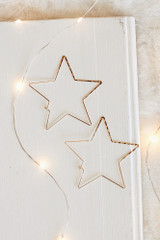 Flat Lay of Gold Star Hoop Earrings
