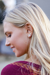 Model wearing Gold Star Hoop Earrings