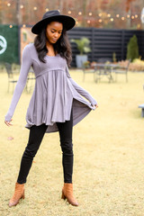 Model wearing a Ribbed Knit Tunic with a black wide brim hat