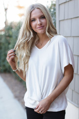 White - Dress Up model wearing a Brushed Knit Knotted Top with black pants