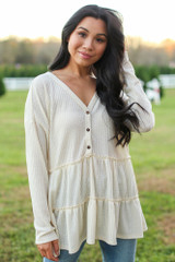 Ivory - Model wearing a Waffle Knit Tiered Babydoll Top