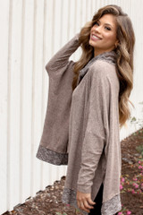 Side view of oversized knit top