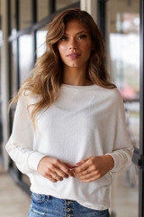 Ivory - Model wearing an Oversized Knit Top with skinny jeans
