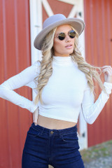 White - Model wearing a Mock Neck Crop Top with a wide brim hat