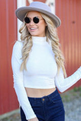 White - Dress Up model wearing a Mock Neck Crop Top with a wide brim hat