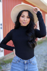 Black - Model wearing a Mock Neck Bodysuit with skinny jeans and a wide brim hat