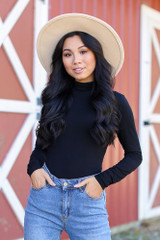 Black - Dress Up model wearing a Mock Neck Bodysuit with jeans and a wide brim hat