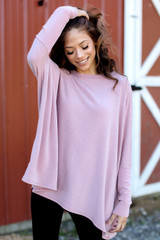 Blush - Model wearing an Oversized Knit Top with a wide brim hat