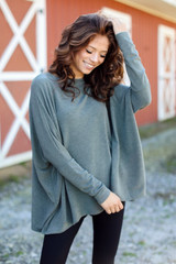 Olive - Model wearing an Oversized Knit Top with a grey wide brim hat