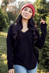 Front view of Dress Up girl wearing a black waffle knit top