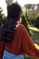 Back view of Dress Up model wearing a camel waffle knit