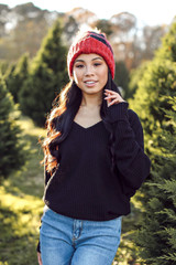 Black - Model wearing a Waffle Knit Top with a beanie