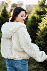 Back view of Dress Up model wearing a hooded Cropped Sherpa Jacket